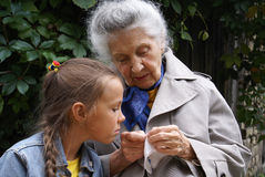 Granddaughter and her grandmother Stock Photography