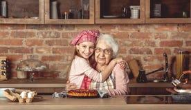 Granddaughter hug her happy grandmother royalty free stock photos