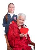 Granddaughter hugging her grandmother Stock Photos