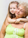Granddaughter hugging her grandmother Royalty Free Stock Photo
