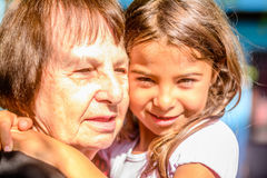 Granddaughter hugging her Grandmother. Granddaughter is hugging her Grandmother and showing affection Royalty Free Stock Photography