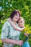 Granddaughter hugs her grandmother Stock Photos
