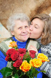 Granddaughter kissed grandmother Royalty Free Stock Photography