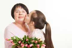 The granddaughter kisses the grandmother Royalty Free Stock Photo