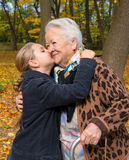 Granddaughter kissing her grandmother Royalty Free Stock Images