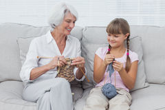 Granddaughter learning how to knit with grandmother Royalty Free Stock Photo