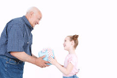 Granddaughter making a present to grandfather Stock Photography