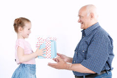 Granddaughter making a present to grandfather Royalty Free Stock Photo