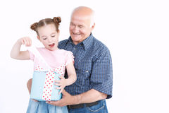 Granddaughter making a present to grandfather Royalty Free Stock Image