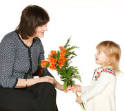Granddaughter presenting bunch of flowers  Royalty Free Stock Image
