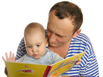 Granddaughter read book Stock Photography