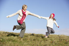 Granddaughter Running With Grandmother Royalty Free Stock Image