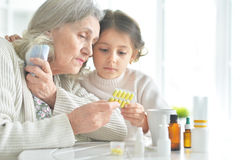 Granddaughter takes care of a sick grandmother Stock Photos