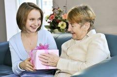 Granddaughter visiting grandmother royalty free stock photos