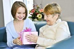 Granddaughter visiting grandmother Royalty Free Stock Image