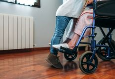 Granddaughter visiting her grandmother in wheelchair Royalty Free Stock Photography