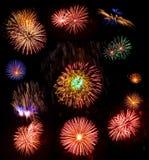Grande accumulazione dei fuochi d'artificio reali isolati sul nero Fotografia Stock