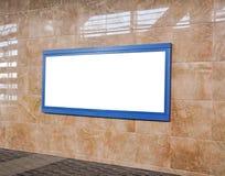 Grande affiche sur la station de métro Photographie stock