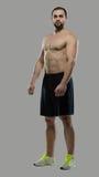 Grande allenamento Ritratto del culturista professionale muscolare e Immagine Stock