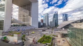 The Grande Arche and skyscrapers timelapse hyperlapse in the La Defence business district of Paris, France. stock video footage