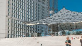 The Grande Arche with stairs timelapse in the La Defence business district of Paris, France.