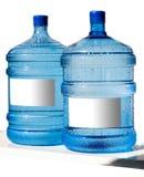 Grande bottiglia di acqua isolata su una priorità bassa bianca Fotografie Stock Libere da Diritti