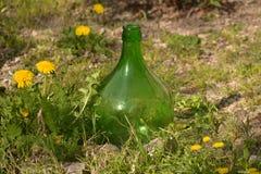 Grande bottiglia di vino verde fotografia stock
