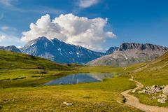 Grande Casse is reflected in the Plan du Lac lake. stock image