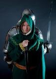 Grande cavaleiro que permanece com assassino Fotografia de Stock