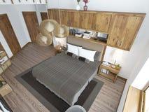 Grande chambre à coucher lumineuse dans le grenier Photographie stock