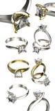 Grande collection avec des bagues à diamant Fond noir de bijou de tissu d'or et d'argent Photo stock