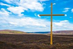 Grande croix dans l'emplacement rural, Islande Images stock