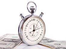 Grande cronometro con soldi Fotografia Stock Libera da Diritti