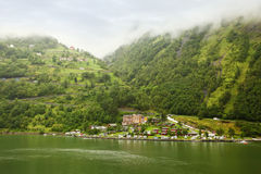 Grande Fjord Hotel and mountain in fog. GEIRANGER - JUNE 28: Grande Fjord Hotel and mountain in fog on JUNE 28, 2011 in Gieranger, Norway. Hotel located near Royalty Free Stock Photography