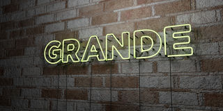 GRANDE - Glowing Neon Sign on stonework wall - 3D rendered royalty free stock illustration Stock Photography