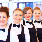 Grande grupo de empregadas de mesa Fotos de Stock
