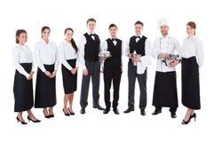 Grande gruppo di camerieri e di cameriere di bar fotografia stock
