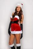 Grande image de Santa de fille sexy d'aide pour créer des cartes postales de salutation de vacances Photos stock