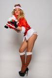 Grande image de Santa de fille sexy d'aide pour créer des cartes postales de salutation de vacances Images libres de droits