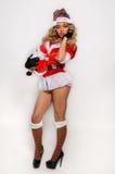 Grande image de Santa de fille sexy d'aide pour créer des cartes postales de salutation de vacances Image stock
