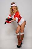 Grande image de Santa de fille sexy d'aide pour créer des cartes postales de salutation de vacances Images stock