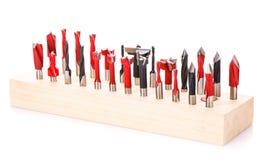 Grande insieme dei taglienti per legno nel supporto di legno isolato Fotografia Stock