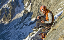 Grande Jorasses. Climber enjoying his dinner, before a bivouac, in the Cassin route of the Grande Jorasses, Alps. Chamonix, Mont Blanc region, France Royalty Free Stock Images