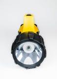 Grande lampe-torche jaune tenue dans la main avec l'angle réglable d'isolement sur le fond blanc Images libres de droits