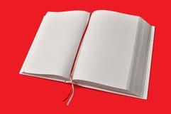 Grande libro bianco aperto sulla zolla rossa Fotografia Stock Libera da Diritti
