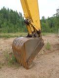 Grande paletta dell'escavatore della macchina della costruzione Immagini Stock Libere da Diritti