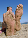 Grande piede e grande uomo Immagini Stock Libere da Diritti