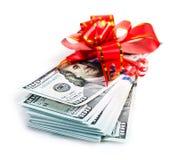 Grande pila di dollari con l'arco rosso Fotografie Stock