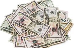 Dollars américains sur un fond blanc Photographie stock libre de droits