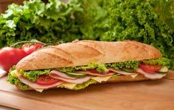 Grande prosciutto & panino di sottomarino svizzero. Fotografia Stock